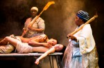 Bongile Mantsai (as John), Hilda Cronje (as Julie), Thoko Ntshinga (as Christine), Tandiwe Nofirst Lungisa (as ancestral apparition) in Mies Julie by Yael Farber. Photograph by Murdo MacLeod